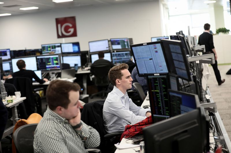 ? Reuters. Traders look at financial information on computer screens on the IG Index trading floor