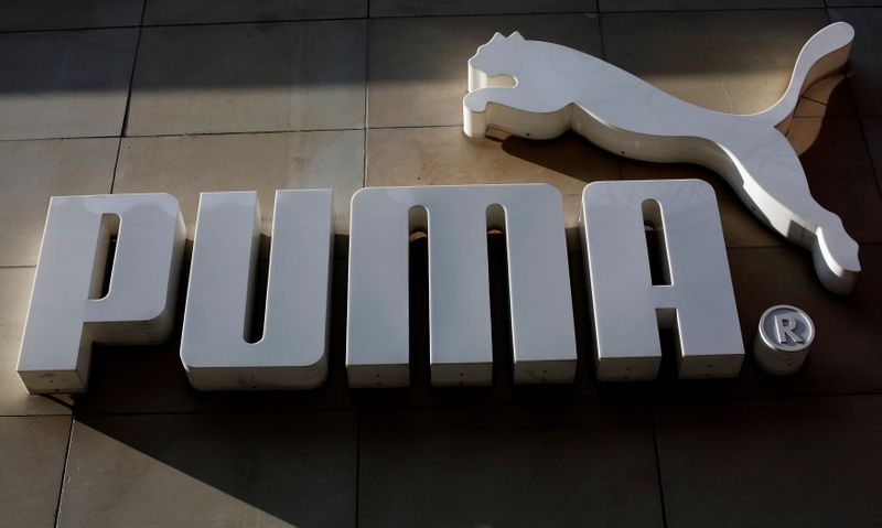 © Reuters. The logo of German sports goods firm Puma is seen at the entrance of one of its stores in Vienna