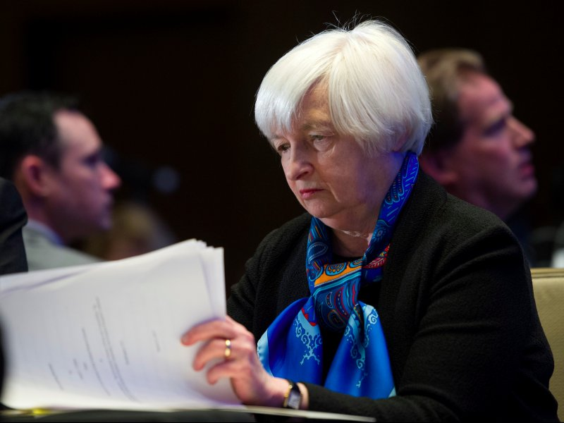 © Cliff Owen/AP, Federal Reserve Chair Janet Yellen waiting to speak at the Federal Reserve System Community Development Research Conference in Washington on March 23.