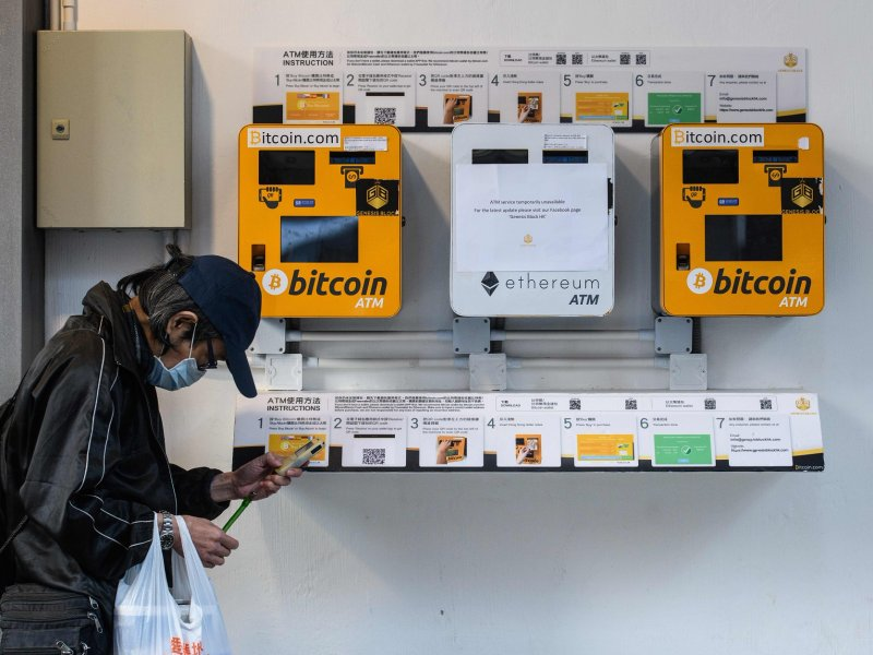© ANTHONY WALLACE/AFP/Getty Images), ATMs used for the digital currency bitcoin seen December 18 in Hong Kong.