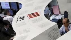 Nikkei edges up in thin trade; Toshiba plummets
