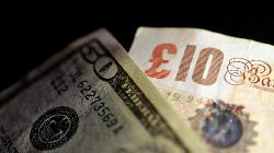 Dollar Consolidates Near Two-Week High; Bank of England to Meet