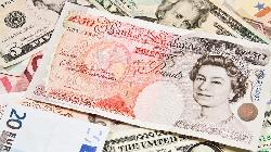 Pound briefly bounces after better than expected survey data
