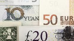 Dollar edges lower, pound firm