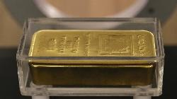 PRECIOUS-Gold holds near 2-week high on uncertainty over virus impact