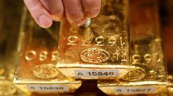 PRECIOUS-Gold flat as Yellen's comments on rates counter muted dollar