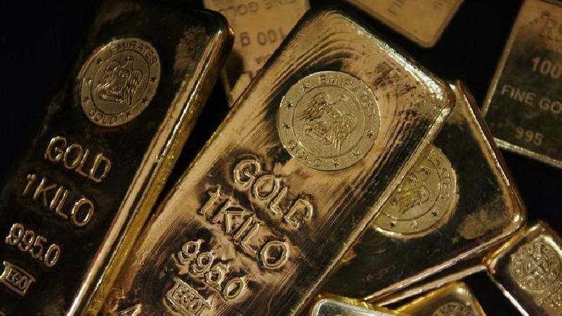 PRECIOUS-Gold up as Fed stance pricks dollar, stocks rally cap gains - Investing.com India
