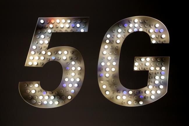 © Bloomberg. A 5G sign illuminated by bulbs stands at Xiaomi Corp. stand on the opening day of MWC Barcelona in Barcelona, ​​Spain.
