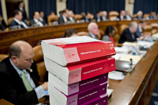 © Bloomberg. Internal Revenue Code books sit during a House Ways and Means Committee markup hearing in Washington, D.C., U.S., on Monday, Nov. 6, 2017. The House tax-writing committee began debate on the GOP's proposed overhaul, kicking off four frantic days for lobbyists and lawmakers to revise a bill that represents President Donald Trump's final hope for a signature legislative achievement this year.