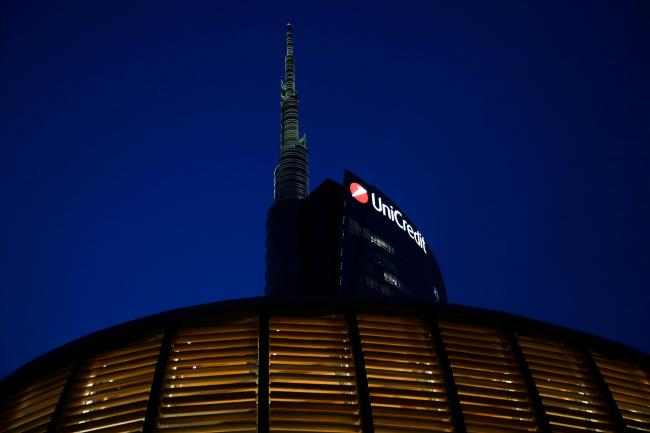 © Bloomberg. The UniCredit SpA headquarters stand in Milan, Italy, on Monday, Sept. 25, 2017. The Italian government sees the country's debt load starting to fall this year as the economy heads into a three-year stretch of 1.5 percent annual growth.