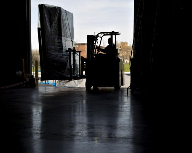 Us july wholesale prices stagnated as service costs fell by bloomberg an employee moves an order of walls on a forklift at the blueprint malvernweather Images