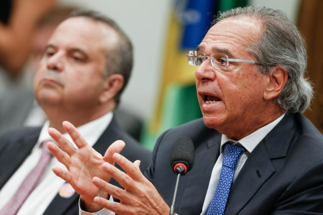 © Bloomberg. Paulo Guedes, Brazil's economy minister, speaks during a public hearing on pension reform before the Lower House Justice and Constitution Committee in Brasilia, Brazil, on Wednesday, April 3, 2019. Guedes sparred with lawmakers over a proposed pension reform during a crucial period for the government as it works to build congressional support for the bill. Photographer: Andre Coelho/Bloomberg