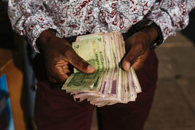 Zimbabwe Dollar Returns A Decade After