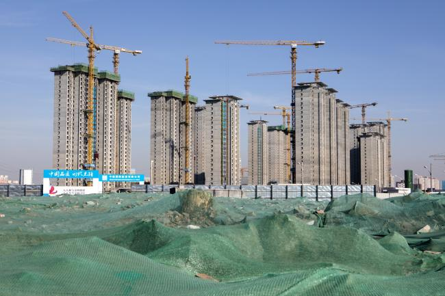 © Bloomberg. Buildings stand under construction in Shijingshan District in Beijing, China, on Thursday, Jan. 17, 2019. China is facing its most difficult economic environment in years. The world's second-biggest economy is in a trade standoff with the biggest -- the U.S. -- and under pressure from President Xi Jinping's