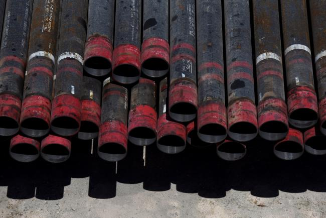 © Bloomberg. Oil drill pipe casings sit at a Colgate Energy LLC site in Reeves County, Texas, U.S., on Wednesday, Aug. 22, 2018. Spending on water management in the Permian Basin is likely to nearly double to more than $22 billion in just five years, according to industry consultant IHS Markit. Photographer: Callaghan O'Hare/Bloomberg
