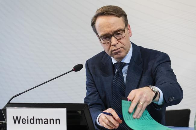 © Bloomberg. Jens Weidmann, president of the Deutsche Bundesbank, looks at documents during the German central bank's annual news conference in Frankfurt, Germany, on Wednesday, Feb. 27, 2019. German Chancellor Angela Merkel's cabinet agreed to extend Weidmann's term as head of the Bundesbank by another eight years.