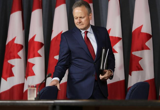 © Bloomberg. Stephen Poloz, governor of the Bank of Canada, arrives for a press conference in Ottawa, Ontario, Canada, on Wednesday, July 13, 2016. Poloz held his benchmark interest rate at 0.5 percent in a rate decision that argued fundamentals remain in place for faster growth. The impact of the U.K. vote to leave the European Union will be modest, knocking 0.1 percent off Canadian gross domestic product over the next two years, while a disappointing export performance was partly due to a temporary decline in U.S. investment, the bank said Wednesday in Ottawa.