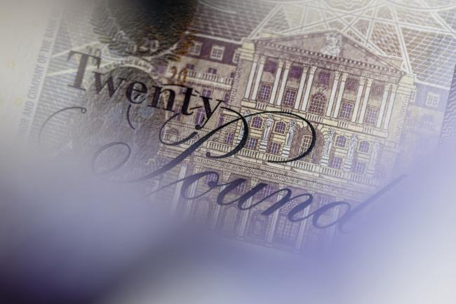 © Bloomberg. An engraving showing the headquarters of the Bank of England is seen on a British twenty pound banknote, in this arranged photograph in London, U.K., on Thursday, Oct. 13, 2016. The U.K. currency is getting harder to trade, and to predict, because the nation's exit from the European Union has changed the rules of engagement.