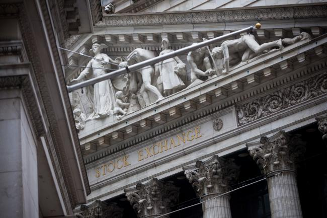 © Bloomberg. The New York Stock Exchange (NYSE) stands in New York, U.S., on Monday, Feb. 12, 2018. U.S. stocks advanced as Treasury yields erased their climb, with financial markets looking to stabilize after the worst week in two years for American equities.