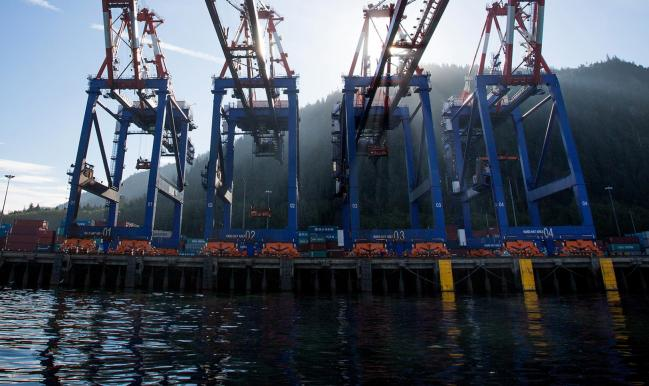 © Bloomberg. Container cranes stand at the Fairview Container terminal of the Port of Prince Rupert in Prince Rupert, British Columbia, Canada, on Tuesday, Aug. 23, 2016. Facing five major energy initiatives in B.C., Canadian Prime Minister Trudeau will choose which constituency to abandon. He's allowed a hydroelectric dam to proceed; pending are decisions on Enbridge Inc.'s Northern Gateway crude pipeline, Petroliam Nasional Bhd.'s LNG project on Lelu Island, a pipeline expansion by Kinder Morgan Inc., as well as a ban on crude oil tankers. Photographer: Ben Nelms/Bloomberg
