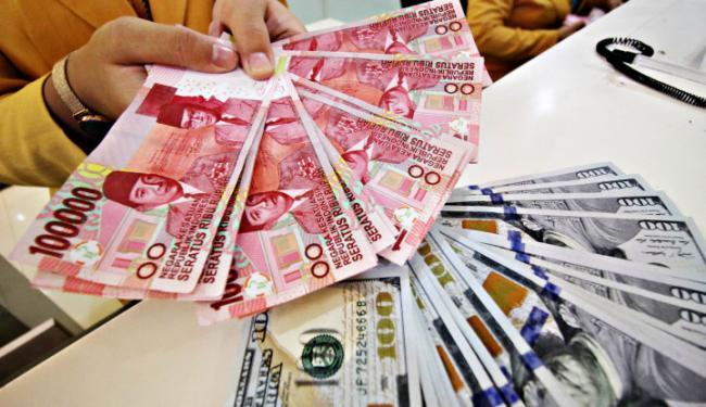© Warta Ekonomi. Jurus Jitu Stabilkan Rupiah Jelang Pemilu