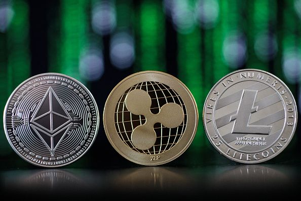 © Bloomberg. LONDON, ENGLAND - APRIL 25: In this photo illustration of the ethereum, ripple and litecoin cryptocurrency 'altcoins' sit arranged for a photograph on April 25, 2018 in London, England. Cryptocurrency markets began to recover this month following a massive crash during the first quarter of 2018, seeing more than $550 billion wiped from the total market capitalisation. (Photo by Jack Taylor/Getty Images)
