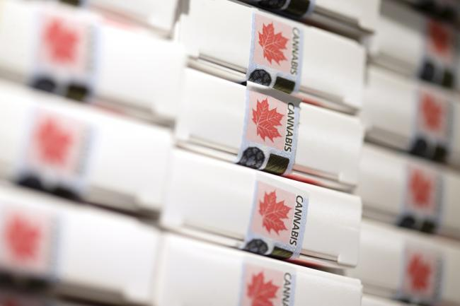 © Bloomberg. Boxes of pre-rolled joints sit stacked at a Quebec Cannabis Society (SQDC) store during a media preview event in Montreal, Quebec, Canada, on Tuesday, Oct. 16, 2018. The SQDC will have twelve stores open in Montreal, as cannabis becomes legal in Canada on October 17. Photographer: Christinne Muschi/Bloomberg