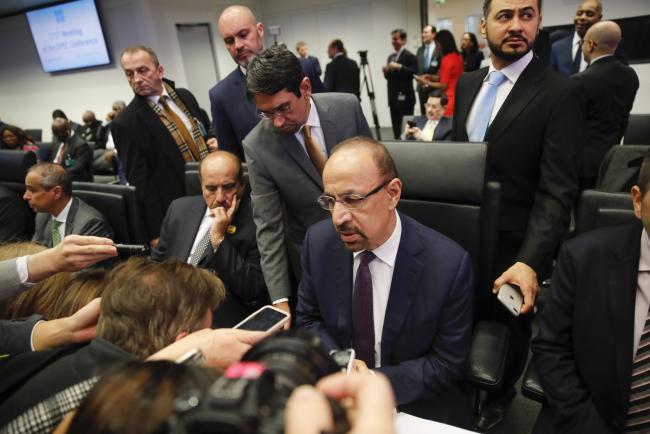 © Bloomberg. Khalid Al-Falih speaks during the OPEC in Vienna, on Dec. 6 Photographer: Stefan Wermuth/Bloomberg