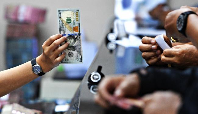 © Warta Ekonomi. Dolar AS Melemah Meski The Fed Naikkan Suku Bunga Acan