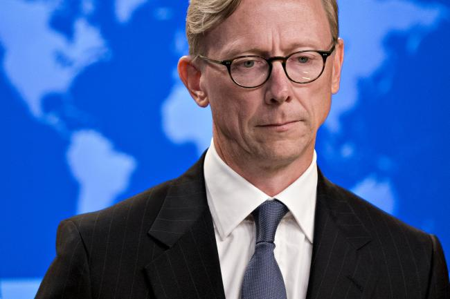 © Bloomberg. Brian Hook, director of policy planning at the U.S. State Department, listens to a question in the briefing room at the State Department in Washington, D.C., U.S., on Thursday, Aug. 16, 2018. Secretary of State Mike Pompeo announced the creation of the Iran Action Group to direct and coordinate U.S. policy toward Iran after withdrawing from the Iran nuclear deal. Photographer: Andrew Harrer/Bloomberg