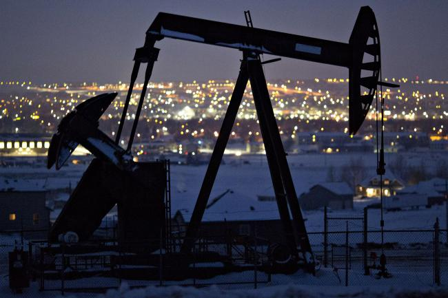 © Bloomberg. A pumpjack operates above an oil well at night in the Bakken Formation on the outskirts of Williston, North Dakota, U.S., on Thursday, March 8, 2018. When oil sold for $100 a barrel, many oil towns dotting the nation's shale basins grew faster than its infrastructure and services could handle. Since 2015, as oil prices floundered, Williston has added new roads, including a truck route around the city, two new fire stations, expanded the landfill, opened a new waste water treatment plant and started work on an airport relocation and expansion project. Photographer: Daniel Acker/Bloomberg