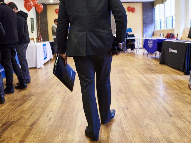 © Bloomberg. A job seeker arrives for a career fair in the Brooklyn borough of New York.