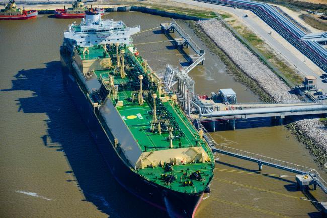 © Bloomberg. The Asia Vision LNG carrier ship sits docked at the Cheniere Energy Inc. terminal in this aerial photograph taken over Sabine Pass, Texas, U.S. Photographer: Lindsey Janies/Bloomberg