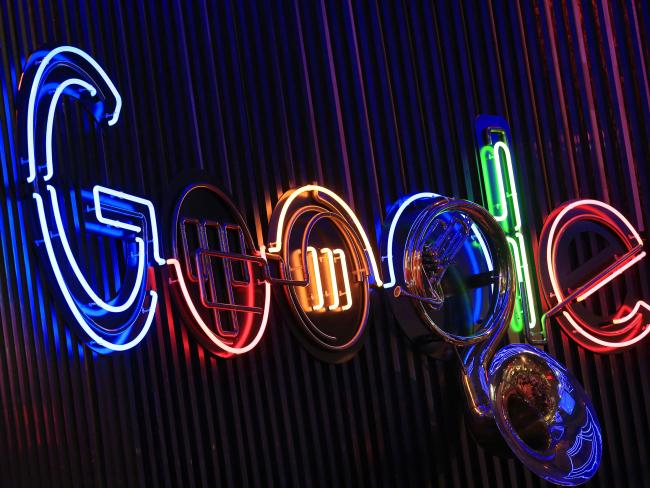 © Bloomberg. The Google Inc. logo hangs illuminated at the company's exhibition stand at the Dmexco digital marketing conference in Cologne, Germany.