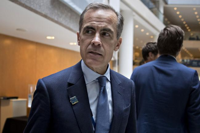 © Bloomberg. Mark Carney, governor of the Bank of England, walks to an International Monetary Fund Committee (IMFC) opening session during the International Monetary Fund (IMF) and World Bank Group Annual Meetings in Washington, D.C., U.S., on Friday, Oct. 7, 2016. The IMF warned this week that rising political tensions over globalization are threatening to derail a world recovery already seeking a reliable growth engine.