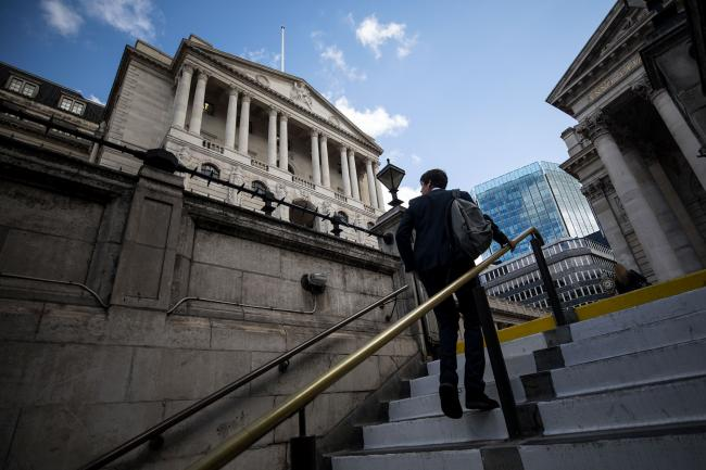 © Bloomberg. A pedestrian walks out of Bank London Underground station exit in view of the Bank of England in the City of London, U.K.