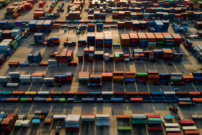 © Bloomberg. Containers sit stacked in this aerial photograph taken above the Uiwang Inland Container Depot (ICD) in Uiwang, South Korea, on Tuesday, May 8, 2018. South Korea is scheduled to release trade figures on May 15.