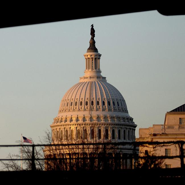 © Bloomberg. The U.S. Capitol stands at sunset in Washington, D.C., U.S., on Thursday, Dec. 12, 2013. A U.S. budget accord is on track to win passage in Congress largely because its most important accomplishment is pushing off automatic spending cuts that neither party likes.