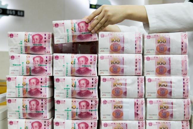 © Bloomberg. An employee arranges genuine bundles of Chinese one-hundred yuan banknotes at the Counterfeit Notes Response Center of KEB Hana Bank in Seoul, South Korea, on Monday, Aug. 14, 2017. China's factory output and investment slowed somewhat in July, according to data released today, yet the yuan appeared not to take the data as negative, if in fact it's paying attention to it at all. Photographer: SeongJoon Cho/Bloomberg