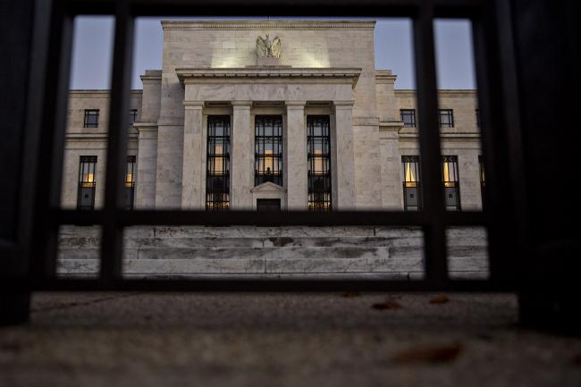 © Bloomberg. The Marriner S. Eccles Federal Reserve building stands in Washington, D.C., U.S., on Friday, Nov. 18, 2016. Federal Reserve Chair Janet Yellen told lawmakers on Thursday that she intends to stay in the job until her term expires in January 2018 while extolling the virtues of the Fed's independence from political interference.
