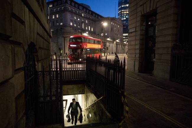 © Bloomberg. A commuter exits an entrance to Bank Underground station in view of the Bank of England in the City of London.