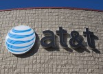 AT&T Leads Telecom Stocks Up Midday; Banks Struggle