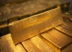 PRECIOUS-Gold eases on firm dollar; markets await Fed guidance