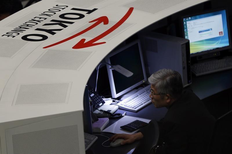 © Reuters.  La Bolsa de Tokio cae un 0,01 % en la apertura hasta los 20.951,84 puntos