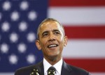 Obama takes swipe at Trump in Mandela address