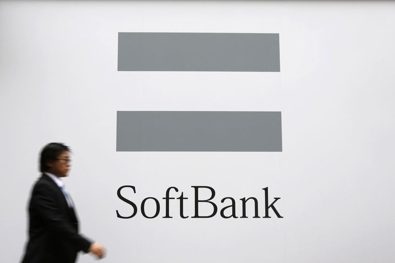 © Reuters.  SoftBank reports Q3 results, updates Vision Fund financials
