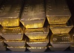 PRECIOUS-Gold eases as dollar holds near multi-month high