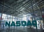 Nasdaq tem leve alta com resultados corporativos; Dow e S&P recuam