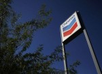 UPDATE 1-Australia puts multinationals on notice after Chevron drops tax appeal