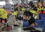 GLOBAL ECONOMY-Asian factories feel pinch from escalating trade conflict